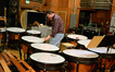 Timpanist Greg Goodall tunes the timpani
