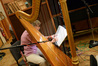 Harpist JoAnn Turovsky makes a correction to her part