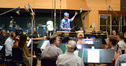 Conductor and orchestrator Tim Davies and the orchestra prepare to record on <em>The Peanuts Movie</em>