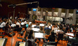 Conductor Nick Glennie-Smith and the Hollywood Studio Symphony perform on <i>Run All Night</i>