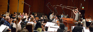 The orchestra performs under the baton of conductor Nick Glennie-Smith