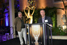 SCL President Ashley Irwin looks on as Emmy nominee Kevin Kliesch (<em>Sophia the First</em>) addresses the crowd