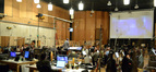 Conductor Tim Davies and the orchestra preparing for a take