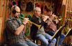 The trumpet section: Dan Rosenboom, Jon Lewis, and Wayne Bergeron