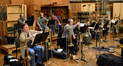 The brass prepare to record the next cue