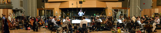Conductor Tim Davies and the orchestra record a cue for <i>Scout's Guide to the Zombie Apocalypse</i>
