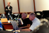 Composer and conductor John Debney and scoring mixer Shawn Murphy watch playback