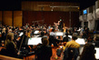 The Hollywood Studio Symphony performs under the baton of composer John Debney