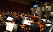 Composer John Debney conducts the orchestra on his score to <i>The SpongeBob Movie: Sponge Out of Water</i>