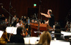 Composer John Debney gives feedback from the podium