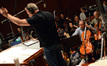 Cellist Steve Erdody and his section play with intensity under the baton of composer John Debney