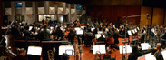 The view of the orchestra and composer and conductor John Debney from the brass section