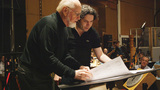 Composer John Williams goes over the opening and end title credits with guest conductor Gustavo Dudamel