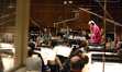 Conductor and orchestrator Tim Simonec and the orchestra prepare to record a cue from composer Michael Giacchino's score to <i>Tomorrowland</i>