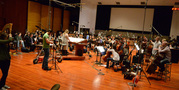 Composer Alison Plante and the orchestra prepare for the next take