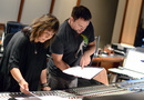 Orchestrator Suzie Katayama goes over the score with scoring mixer Adam Michalak