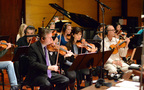 Concertmaster/contractor Mark Robertson and the violin section perform composer Alison Plante's <i>Trimountaine</i>