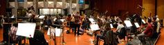 Composer Alison Plante talks with the orchestra before recording her piece <i>Trimountaine</i>