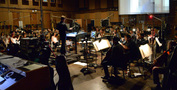 The orchestra records a cue from <i>Almost Christmas</i>