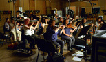 The strings perform pizzicato on a cue