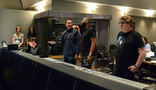 Conductor Nolan Livesay (seated), composer John Paesano talks, director David Talbert, and scoring mixer Alan Meyerson