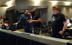 Composer John Paesano discusses a cue with director David Talbert as scoring mixer Alan Meyerson watches the session