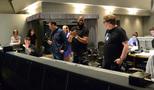 Director David Talbert (center) applauds the music team: conductor Nolan Livesay (seated, left), composer John Paesano, and scoring mixer Alan Meyerson