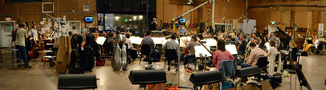 The orchestra records a cue with conductor Nolan Livesay