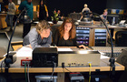 Orchestrator Benoit Grey and composer H�l�ne Muddiman look at a cue