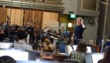 Conductor Eímear Noone prepares to record a cue