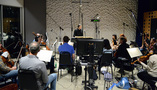 Co-composer/conductor Ludwig G�ransson and the orchestra prepare for the next cue