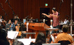 Additional music composer Philip Klein conducting the orchestra