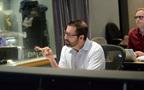 Composer Chris Lennertz listens to the mix