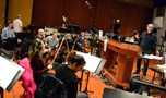 Conductor Michael Kosarin and the musicians enjoy the session