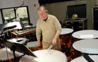 Percussionist Don Williams performs on timpani
