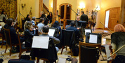 The musicians finish setting up for the session