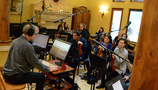 Composer Jeff Beal at work with the violins and violas