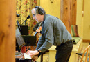 Composer and conductor Jeff Beal checks levels for the session
