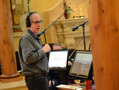 Composer and conductor Jeff Beal at his workstation on the podium