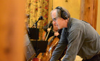 Composer and conductor Jeff Beal prepares a cue