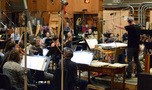 The Hollywood Studio Symphony and composer/conductor John Debney record a cue