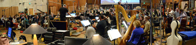 Composer/conductor John Debney and the orchestra record a cue from <i>Ice Age: Collision Course</i>