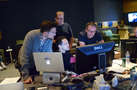 Additional music composer Alex Belcher, music editor Dan Pinder and composer Henry Jackman examine a cue as orchestra contractor Peter Rotter (rear) observes