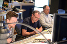 Additional music composer Alex Belcher (obscured), composer Henry Jackman and scoring mixer Chris Fogel