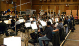 The orchestra prepares for the next cue