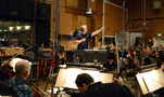 Composer John Debney conducts the orchestra
