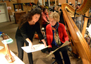 Harpists Marcia Dickstein and Gayle Levant go over a cue together