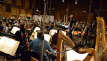 Composer/conductor John Debney talks with the first violins