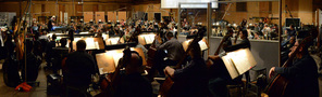 Composer/conductor John Debney records a cue with the orchestra for <i>The Jungle Book</i>