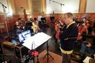 Composer Carlo Siliotto listens as the musicians rehearse a cue